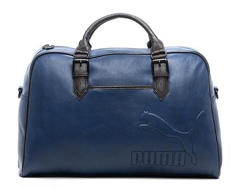c0dcd29d23bc Синяя сумка из полиуретана от Puma смотрится строго. Ширина её 56 см, а  высота 36 см, так влезет всё, что нужно, но без излишеств в виде жбана  протеина.
