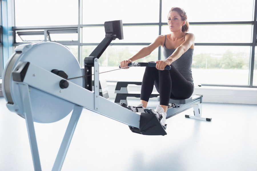 bigstock-Woman-training-on-row-machine--39322954