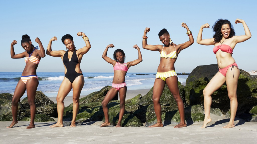 women-striking-power-pose-on-beach