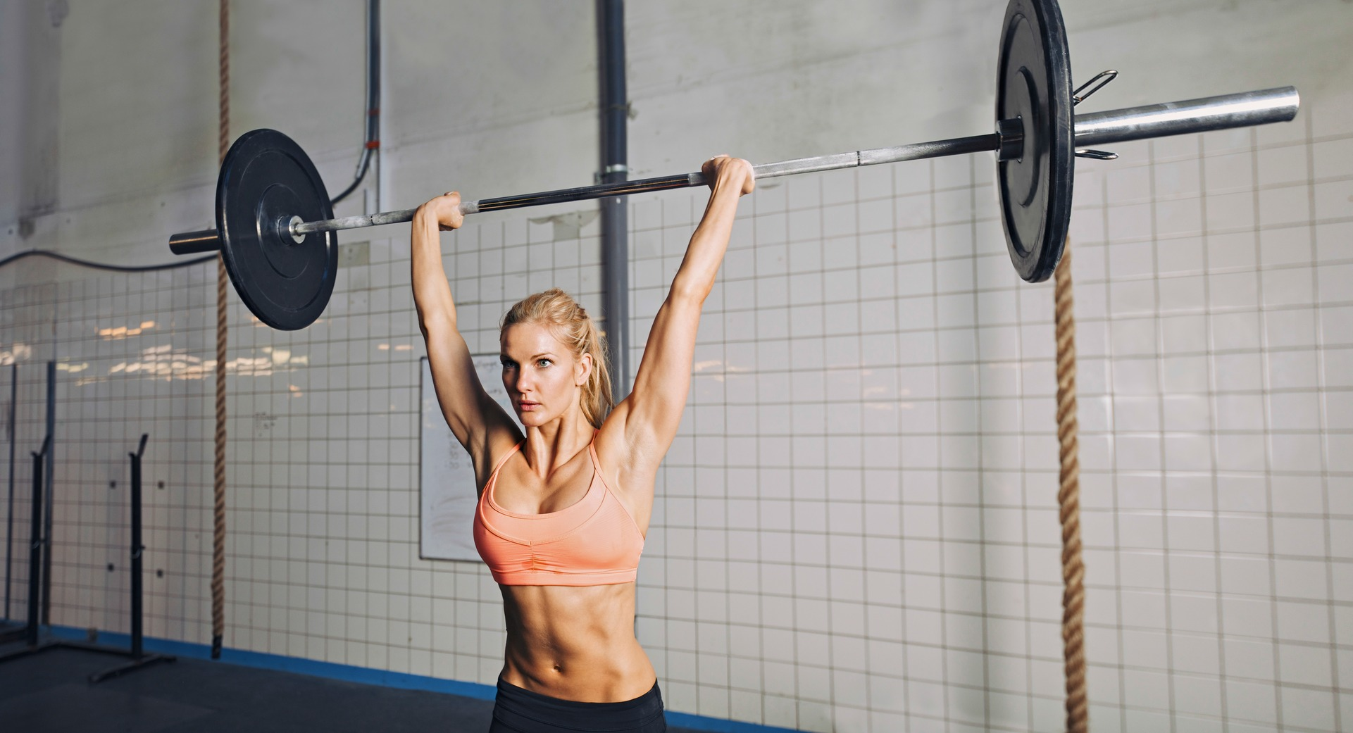 Crossfit woman lifting weights