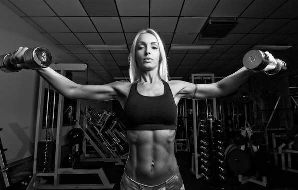 woman-fitness-dumbbells-pose