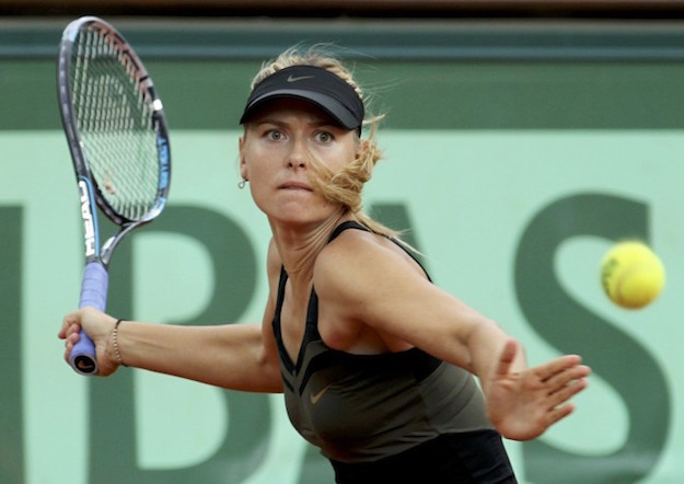 Sharapova of Russia returns the ball to Errani of Italy during their women's singles final match at the French Open tennis tournament at the Roland Garros stadium in Paris